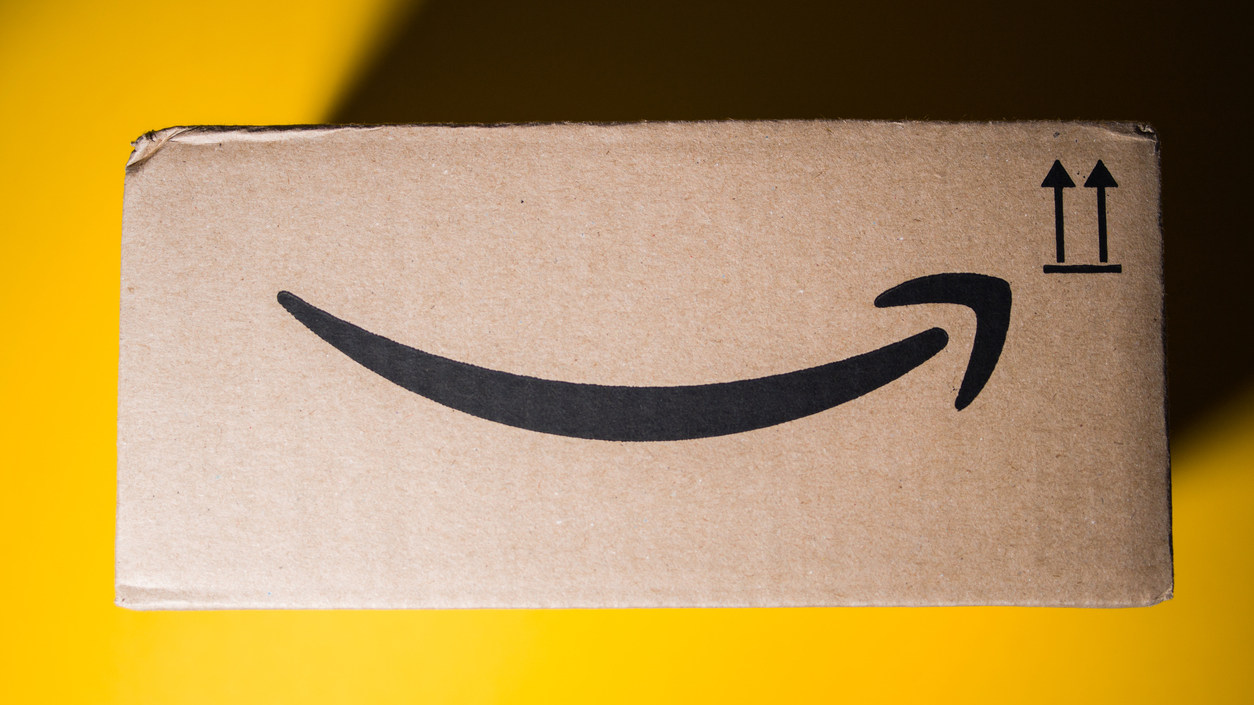 Amazon cardboard box yellow background