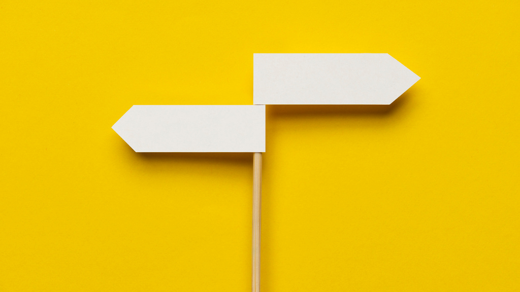Two directional sign on the yellow background.
